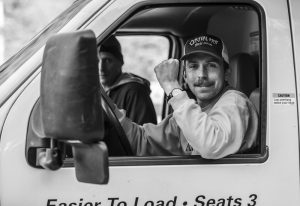 Organizer Mike Girard, stoked on the successful completion of his first World Cup; key staffer Bill Monk rides shotgun. Photo: Khaleeq Alfred